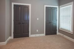 the wall color is Sherwin Williams 7642 Pavestone and the door color is Sherwin Williams 7019 Gauntlet Grey