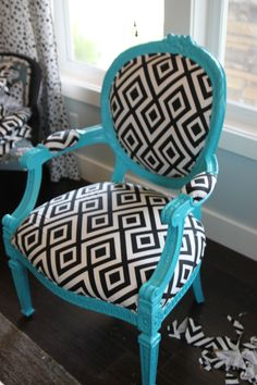 as close to Tiffany blue as we could find in a can of spray paint. The color we ended up going with was the color Seaside in a Rustoleum paint. Pull fabric tight over the bottom cushion and staple to the frame. Also cover both arm pads with fabric and staple.