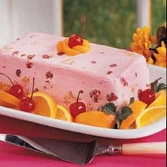 Miss Daisy's Frozen Cherry Salad    1-l6. oz can cherry pie filling    1-14 oz. can crushed pineapple    1-14 oz. can Eagle Brand condensed milk    1-13 oz. can Cool Whip    Chopped Pecans, optional    Mix all ingredients and freeze in either a loaf pan or a 9 x 13 pan. Cut in squares and garnish with Party Salad Topping and a strawberry.
