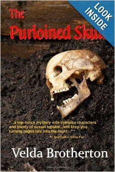 The Purloined Skull by Velda Brotherton.  When dogs dig up a human skeleton people in Cedarton, Arkansas learn that murder can happen even in a small town in the Ozarks. Dal Starr, the newly hired crime scene investigator balks at having local reporter Jessie Stone tag along on his investigation. Sparks fly between the two as they try to learn who was buried under a bluff and who killed him. The discovery of a lost skull threatens to reveal hidden secrets and end two careers.