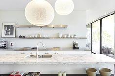 white kitchen + marble bench tops