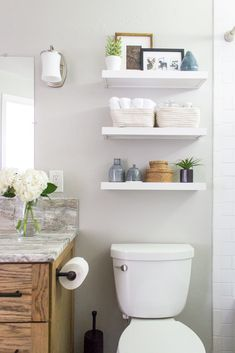 Floating shelves above the toilet. Alaskan Bathroom Makeover Reveal – Shades of … Floating shelves above the toilet. Alaskan Bathroom Makeover Reveal – Shades of … – Frenh Country Bathroom – Toilet Storage, Bathroom Storage, Bathroom Interior, Modern Bathroom, Bathroom Cost, Bathroom Ideas, Bathroom Towels, Bathroom Organization, Master Bathrooms