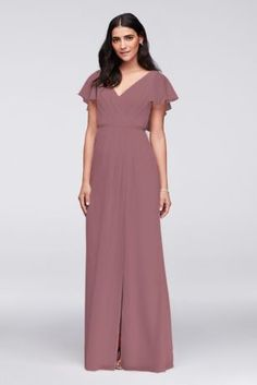 bridesmaid jumpsuits Flowy flutter sleeves, a deep V-back, a flirty skirt slit, and a slim grosgrain ribbon waistband provide pretty detail to this classic, crinkle chiffon gown. Polyester Back zipper; fully lined Dry clean Imported Davids Bridal Bridesmaid Dresses, Bridesmaid Dress Styles, Bridesmaids, Bridesmaid Jumpsuits, Bride Dresses, Chiffon Gown, Flutter Sleeve, Grosgrain Ribbon, Short Sleeves