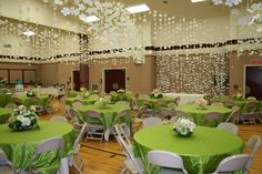 Paper flowers and green satin ribbon streamers.  Attach to clothesline rope, crisscrossed the length of cultural hall, spring luncheon
