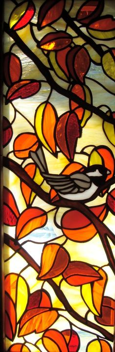 Chickadee bird in autumn leaves. Perfect stained glass for fall.
