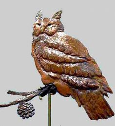 Great Horned Owl Weathervane Great-Horned Owl Weathervane on branch with pine cone. Includes SS Mast, Solid Brass Standard Directionals and 2 New England Hand-Spun Copper Balls. All Maintenance-Free Material Fabricated by Senior Weathervane Artist Lori Rob in our Connecticut Studio Location PLEASE NOTE: Every weathervane on this site was created at the request of a client interested in custom weathervane fabrication. Most are one-of-a-kind, All are Hand-Crafted.