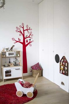 Toddler room with energizing red colour accents.