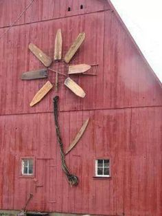 Great idea for old ironing boards on barn!
