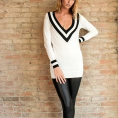 White Varsity Sweater Top White deep plunge varsity sweater top. 55% cotton 45% rayon. Runs true to size. Brand new. Bare Anthology Tops Tees - Long Sleeve