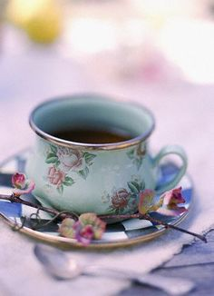 perfect teacup...love the shape o the cup and this of vintage floral with checkered.