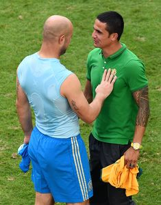 Pepe Reina Photos Photos - Pepe Reina of Spain and Tim Cahill of Australia interact after Spain's 3-0 win during the 2014 FIFA World Cup Brazil Group B match between Australia and Spain at Arena da Baixada on June 23, 2014 in Curitiba, Brazil. - Australia v Spain: Group B - 2014 FIFA World Cup Brazil
