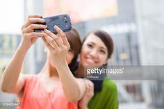 Two women are taking selfie at Shibuya crossing