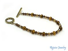 """""""Smokey Topaz beautiful 8 inch bracelet with vintage beads. Original price $27 SALE!  $19 www.rejoicejewelry.com"""