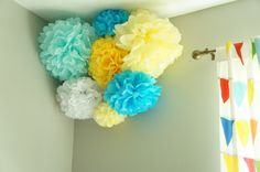 Colorful tissue pompoms - perfect shot of color in this gray #nursery!