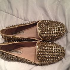 Steve Madden shoes. Gold studded with gold glitter flats. Worn a few times, very comfortable. True to size Steve Madden Shoes Flats & Loafers