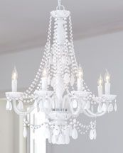 This chandelier makes me swoon. I am crazy for vintage milk glass and this thing is dripping in its younger cousin.