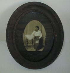 The note on the back of this African American Black woman's photo says this is Essie. She is giving this photo to her sister Annie. Its dated 1917. Unknown location.