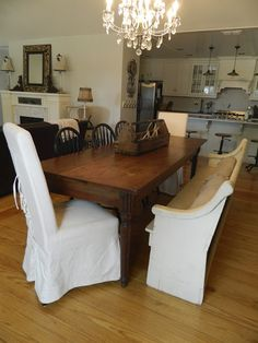 After Dining Room, church pew, harvest table, 1940's chandelier, open floor plan