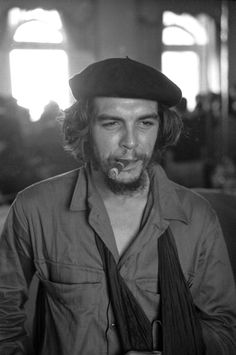 Closeup of Argentinianborn Cuban revolutionary Ernesto Che Guevara with a cigar in his mouth and his left arm in a sling Havana Cuba January 7 1959
