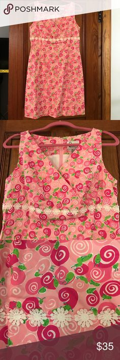 Snail Roses Lilly Pulitzer Dress Beautiful white label Lilly Pulitzer dress in the snail print. In excellent used condition. Only worn dress a handful of times. Size 8. Lilly Pulitzer Dresses Midi