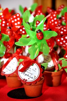 Ladybug party favors, terra cotta flowerpots with tags and ladybugs #ladybugfavors #flowerpots