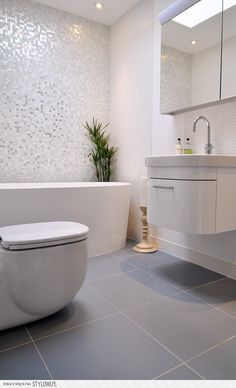 White and Grey modern bathroom by Kia Designs - wall hung vanity gives more floor space...