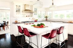 White kitchen with maroon bar stools