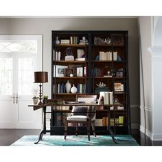 Balancing dramatic scale with flea marketing-find design, the De Niro Bookcase offers comfortable seating in fresh lines, lush velvets, and buttery top grain leather. This storage solution embellished with iron and brass details resemble libraries of the 1940's, provide smart and stylish organization for any room.