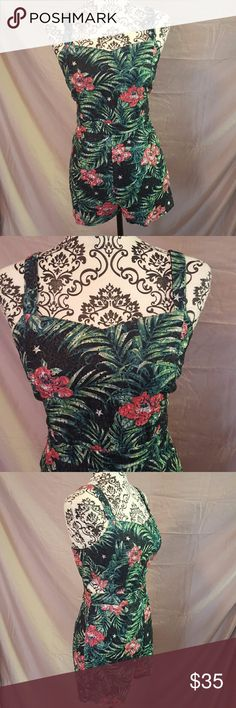 """Tropical Eyelet Cutout Romper Beautiful romper! Size Large. It is black with tropical print and eyelet fabric. Lined. Back zipper. The sides of the waist have cutouts. So cute!  Measurements (laying flat): Bust-16.5"""" Waist-15"""" Hips-16.5"""" Minty Gogo Pants Jumpsuits & Rompers"""