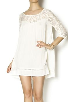 This beautiful lightweight ivory tunic features a sweetheart neckline, lace topped shoulders and 3/4 length sleeves. The subtle lace trim around the bottom hem adds vintage charm. The dress is unlined and slightly sheer so pair with a slip. Wear this white romantic dress with blush kitten heels for a late dinner date.