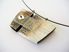 """Long Ago into the Future"" - polymer clay and resin pendant by Sonya Girodon."