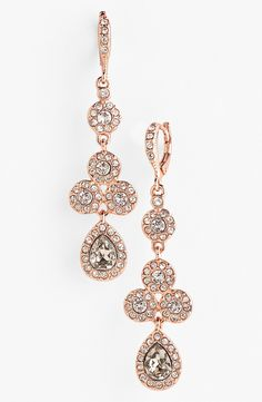 Blingy crystal drop earrings in rose gold.