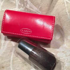 Clarins Kabuki Brush with Mirrored Case Authentic Clarins Kabuki brush with mirrored red case. Price is firm. Clarins Makeup Brushes & Tools