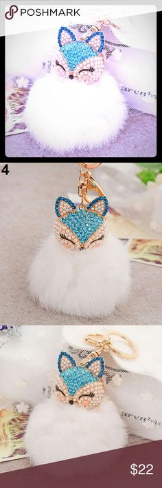 "Now Selling Blue Fox Plushball Keychain These are some very cute keychains !! This keychain is made out of high quality alloy for the chain  and rhinestones !! This is the perfect unique gift for yourself or a friend ;) !! The total lenghth of the keychain is about 16cm/6.30"". Limited Supply!! Accessories Key & Card Holders"