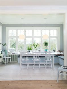 house of turquoise...love those white farm house chairs!