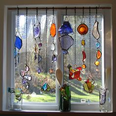 ~ stained glass ornaments draped in a window -