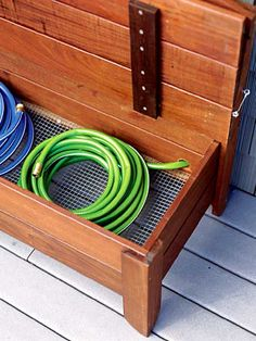 hose - 0604_sunset_bench2_l hose bench http://www.knottinghillinteriors.com/blog/2011/05/interior-design-little-luxury-decorative-hose-storage-containers/