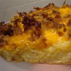 Classic breakfast favorites come together in this layered hash brown casserole with eggs, cheese, and sausage.