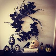 21 Real Halloween Decorating Ideas to Copy A twig and bat wreath itself is eye-catching, but throw in a few skulls and witches, and you've got yourself a winning combo.