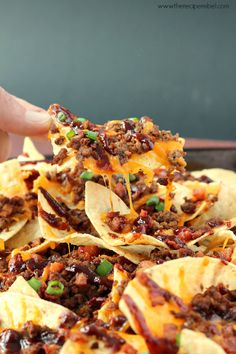 BBQ Bacon Cheeseburger Nachos: the best nachos you've ever had! Barbecue sauce, ground beef, bacon, cheddar cheese, green onions and all the burger toppings you want. Perfect for movie night or game day!