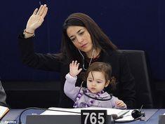 Currently in love with this photo. Italian MEP Licia Ronzulli with her daughter Vittoria in European Parliament.