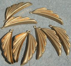 8 Brass vintage wing shape findings with loop by debsdesigns401 on Etsy