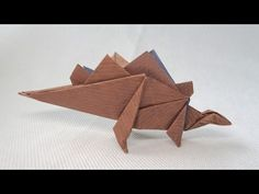 Origami Tutorial: How to make a Origami Dinosaur Stegosaurus Diy Origami, Origami T Rex, Dinosaur Origami, Paper Dinosaur, Origami Cube, Origami Ball, Origami And Kirigami, Origami Dragon, Paper Crafts Origami