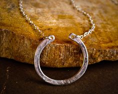 Horseshoe Necklace - Sterling Silver Simple Hammered Horseshoe Pendant - Minimalist Jewelry, Simple Silver Necklace. $24.00, via Etsy.