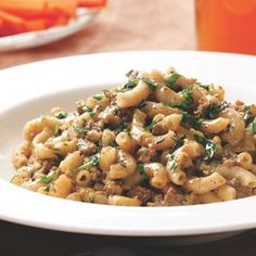 Very finely chopping onion, mushrooms and carrots in the food processor is not only fast--it makes the vegetables hard to detect for picky eaters. They also form the base for the sauce of this ground beef skillet supper. Make it a meal: Serve with a green salad.