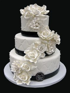 This is the cakes we both fell inlove with ! We would replace the pearls in the quilting with bling and add some sparkle on the roses as well...perfect image of what our wedding cake should be