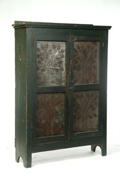 """AMERICAN PUNCHED-TIN PIE SAFE.  Mid19th century, poplar. Large size, with two doors with replaced tin panels, and old green paint. Panels have tree designs and """"1840"""". 71""""h. 50.5""""w. 15.5""""d."""