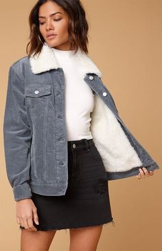 PacSun introduces their Sherpa Corduroy Trucker Jacket to keep you cozy all season long. This trucker jacket features a corduroy fabric, soft sherpa lining and collar, button-flap chest pockets, front hand pockets, and a relaxed fit.    Long sleeves  Sherpa lining  Corduroy fabric  Button-flap chest pockets  Front hand pockets  Model is wearing a small  Body: 100% cotton; Lining: 100% polyester  Machine washable