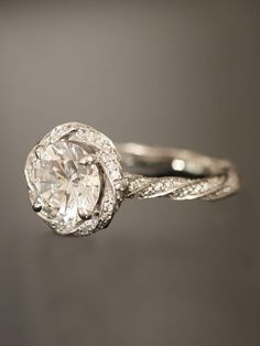 Very unique in design, I like the round cut diamond center and the twist is growing on me the more that I look at it.