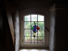Pallet wood window frame made to house this 'Mackintosh rose' leaded light.